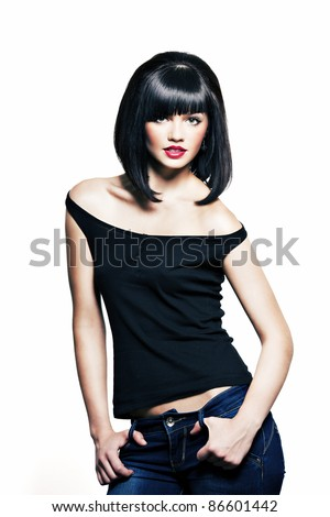 beautiful girl with perfect skin in a black shirt and jeans with black short hair and bright red lipstick