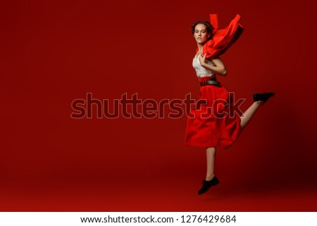 72fa23f25 Contemporary modern dance on a white background isolated. Beautiful girl  with pink hair wearing bright clothes over red background. Bright style,  fashion