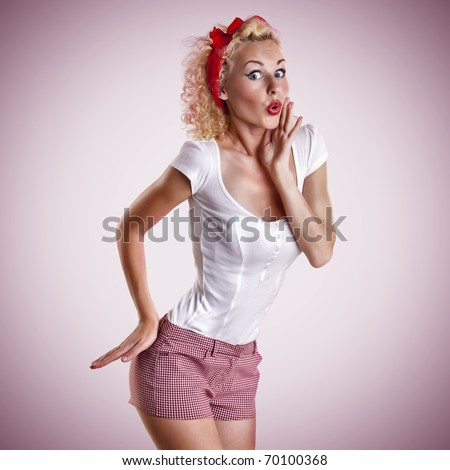 beautiful girl with pretty smile in pinup style on pink background