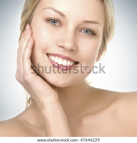 beautiful girl with pretty smile on blue gradient background - stock photo