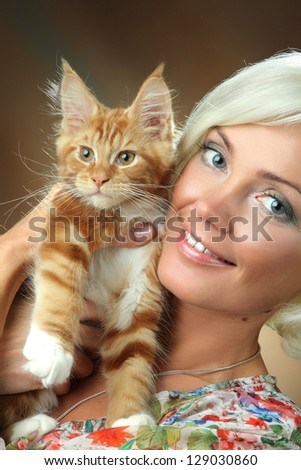 beautiful girl with red cat