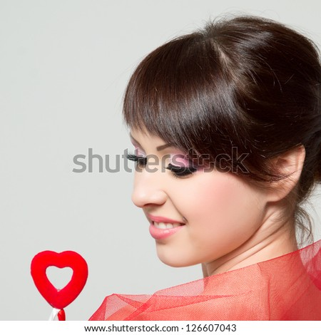 beautiful girl with red fabric and red heart