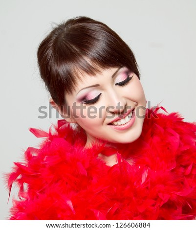 beautiful girl with red feathers, beautiful face with make up