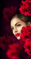 Beautiful Girl With red Peony Flowers portrait. Beauty high fashion Model Woman Face close-up. Perfect Skin. Professional Make-up. Makeup. Lipstick, foundation, mascara ads. Vogue style Fashion Art