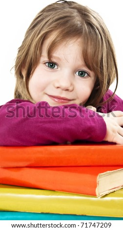 Beautiful girl with school books on the table.