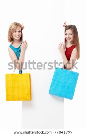 Beautiful girl with shopping bags and billboards