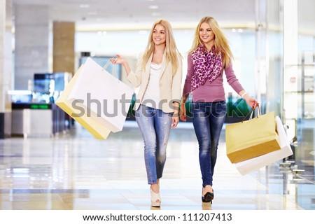 Beautiful girl with shopping bags in shop