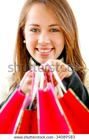 beautiful girl with shopping bags - isolated over a white background