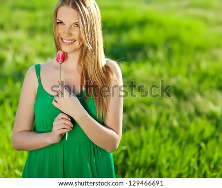 Beautiful girl with spring flower - stock photo