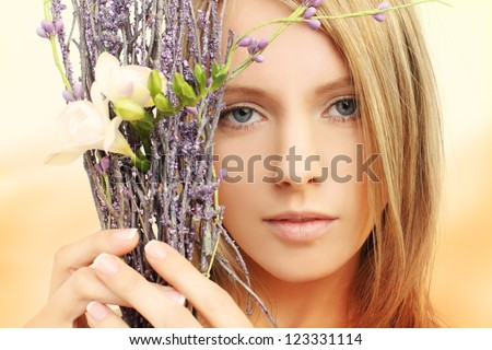 Beautiful girl with spring flowers - face closeup, portrait