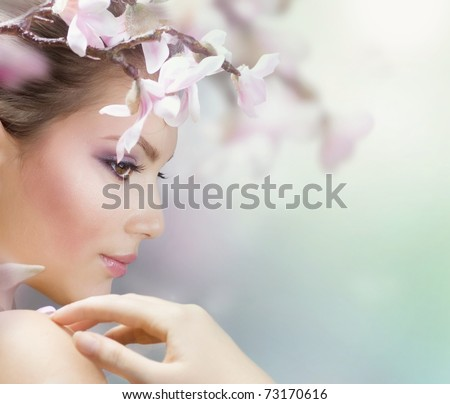 Beautiful Girl with Spring Flowers.Fresh skin