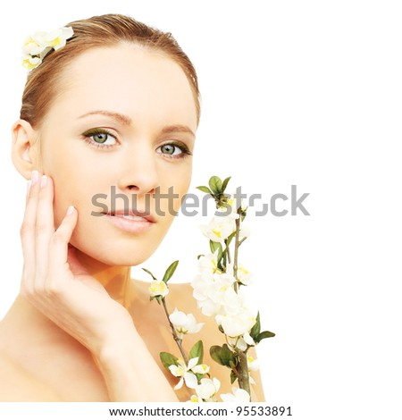 Beautiful girl with spring flowers isolated on white