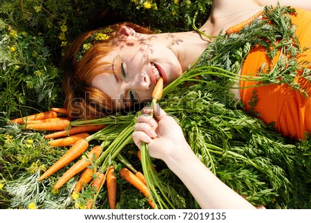 Beautiful girl with tasty carrot and flowers