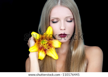 beautiful girl with the flower of the Lily in her hand