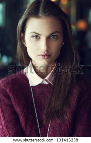 beautiful girl with the Spanish appearance in a cafe