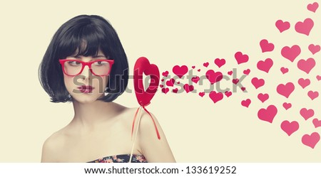 Beautiful girl with toy heart and abstract hearts.