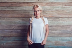 Beautiful girl with two braids in a white T-shirt. Mock-up.