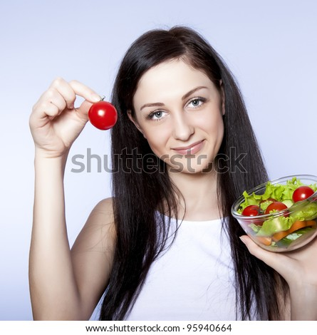 beautiful girl with vegetable salad