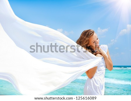 Beautiful Girl With White Scarf on The Beach. Travel and Vacation.