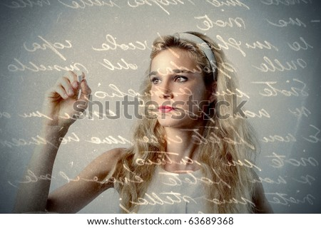 Beautiful girl writing a letter