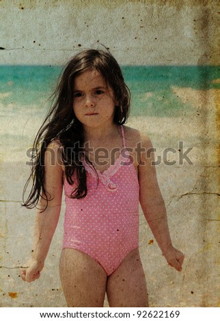 beautiful girl 5 years old on the beach.  Photo in old image style.