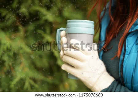 beautiful girl young student outdoors in park outdoors in winter autumn holds in hands white gloves mitts cup of coffee or tea #1175078680