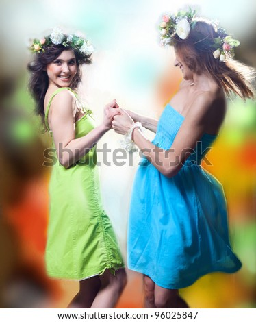 Beautiful girls dancing. Spring.