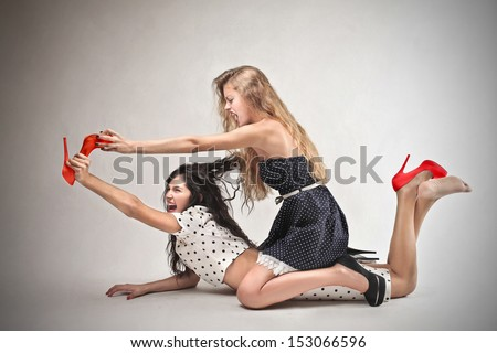 beautiful girls fighting tearing shoes
