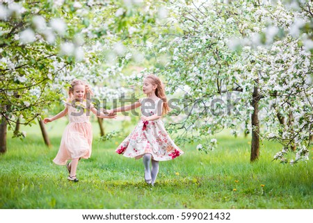 Stock Photo Beautiful girls in blooming apple tree garden enjoy warm spring day