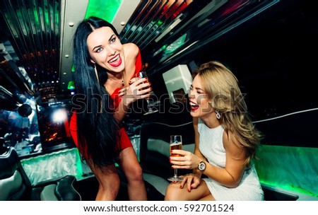 Beautiful girls making party in the limousine #592701524