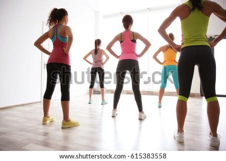Beautiful girls training in gym #615383558