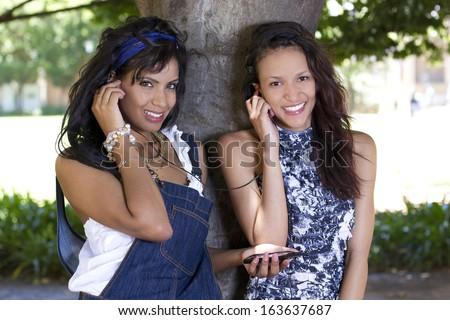 Beautiful girls with earphones