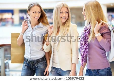 Beautiful girls with shopping bags in shop