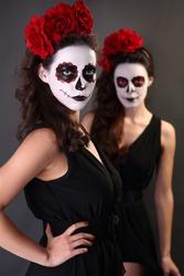 Beautiful girls with sugar skull makeup