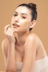 Beautiful Glamour woman touching chin smile with clean and fresh skin Happiness and cheerful with positive emotional,isolated on Beige background,Beauty Cosmetics and spa Facial treatment Concept