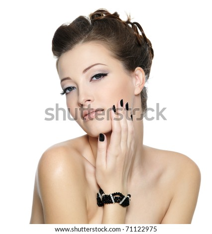 Beautiful glamour young woman with black nails and stylish hairstyle posing on white background