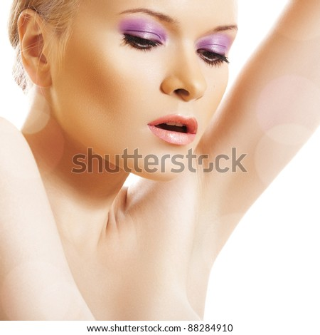 Beautiful glamourous woman model with evening violet makeup on white background. Night party style