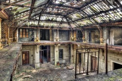 Beautiful glass roof inside the hall of an abandoned central office
