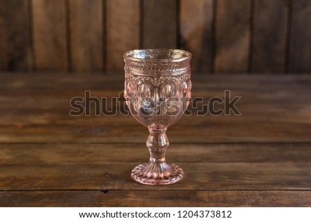 Beautiful glasses on a dark wooden background #1204373812