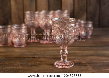 Beautiful glasses on a dark wooden background #1204373833