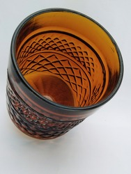 beautiful glassware in bright brown colour,  more colourful in shiny and transparent line and crisscross pattern and texture.this fragile glass use to drink or just for decoration also can be a vase