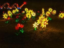 Beautiful glowing yellow artificial flower.garden light installations