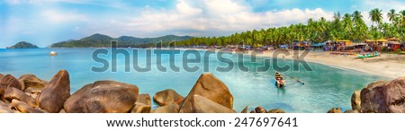 Beautiful Goa province beach in India with fishing boats and stones in the sea  - Shutterstock ID 247697641