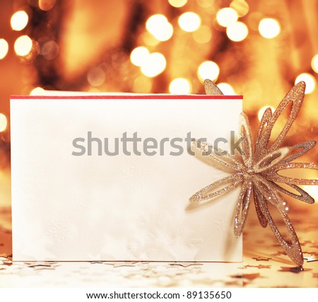 Beautiful gold happy Christmas card,winter holiday background, decoration postcard with snowflakes abstract over defocused lights