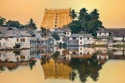 Beautiful gold Sree Padmanabhaswamy temple reflected in a pond at sunset, Thiruvananthapuram city, Kerala, south India