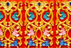 Beautiful gold Thai traditional style in temple Thailand on red background