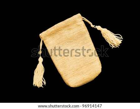 Beautiful Gold / Yellow Silk bag / pouch to hold jewelry and delicate items isolated on black background