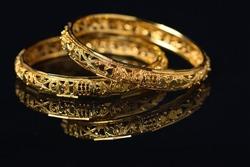 Beautiful golden bangles isolated on black backround