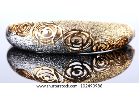 Beautiful golden bracelet on grey background