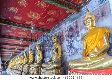 Beautiful golden Buddha images at corridor in Wat Suthat temple, Thailand. Wat Suthat Thepphawararam is a royal temple of the first grade in Bangkok. Construction of the temple was completed in 1847.
